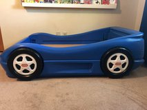 Blue toddler race car bed in Aurora, Illinois