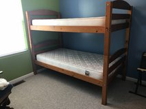 Bunk beds with new mattresses and ladder in New Lenox, Illinois