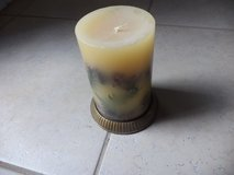 Candle with brass stand in The Woodlands, Texas