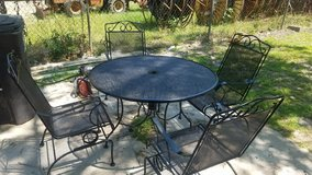 Heavy Wrought Iron Patio Table Set in Spring, Texas