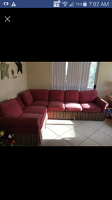 Red sectional needs cleaning in Yucca Valley, California