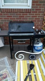 Weber grill with a full tank of propane in New Lenox, Illinois