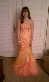 Peach and pink colored formal dress in Fort Campbell, Kentucky