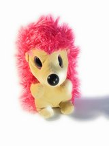 Pink furry porcupine stuffed toy in Bellaire, Texas
