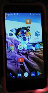 Lg Coolpad cellphone with case in Leesville, Louisiana