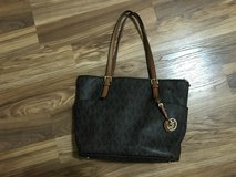 Brown authentic Michael Kors purse in Conroe, Texas