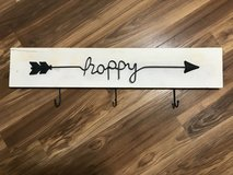 "3 hook ""happy"" wood wall sign in The Woodlands, Texas"