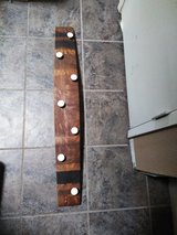 Coat rack made from a wine barrel in Travis AFB, California