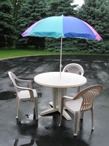 Patio Table , Chairs and Umbrella in Plainfield, Illinois