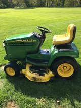 John Deere tractors, carts, decks,wheel weights, etc. in Oswego, Illinois