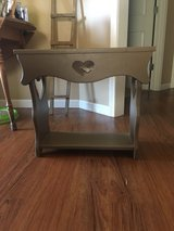Small painted all wood stand in Fort Polk, Louisiana