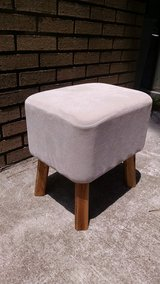 Small cream ottoman in Beaufort, South Carolina
