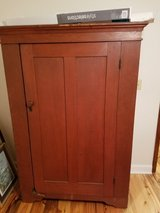 Very Old  rustic slighty  reddish cabinet in Beaufort, South Carolina