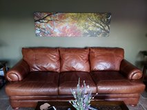 100% leather couch and chair with ottoman in Batavia, Illinois