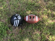 Brand new football and soccer ball. in Fort Leonard Wood, Missouri