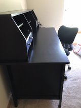 black desk and chair in Lockport, Illinois
