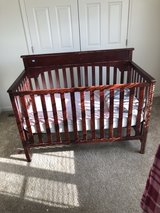 cherry brown baby crib in Fort Bragg, North Carolina