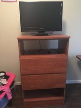 Two drawer dresser with attached TV and remote in Fort Leonard Wood, Missouri