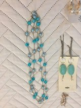 Earrings and necklace in Bellaire, Texas