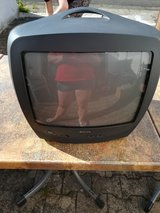 small TV with remote in Ramstein, Germany