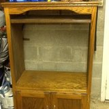 Oak entertainment cabinet in Fort Campbell, Kentucky