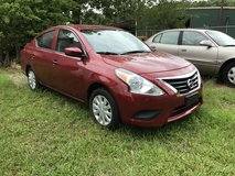 Nissan Versa 2016 Red 4 door in Fort Polk, Louisiana