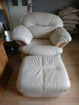 Three seater leather couch two single chairs and a footstool in Lakenheath, UK