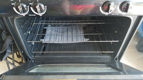 black gas oven and hood in Plainfield, Illinois