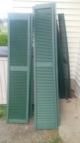 Green Slatted Shutters in Fort Knox, Kentucky