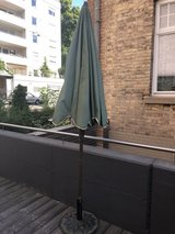 Free outdoor/patio umbrella and stand in Stuttgart, GE