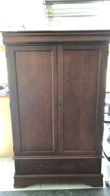 Cherry hard wood entertainment center/ cabinet in Jacksonville, Florida