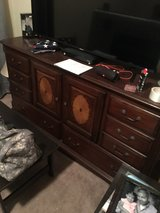 queen bed frame and dresser with mirror in El Paso, Texas