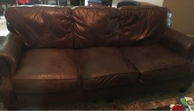 brown leather couch and love seat in Kingwood, Texas