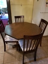 nice table with chairs in Kingwood, Texas