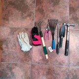 Garden tools, 2 pairs of garden gloves, and a hammer in Alamogordo, New Mexico