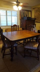 Old antique expandable dining table with 4 chairs in Fairfield, California