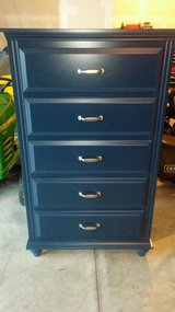 Navy blue dresser in Shorewood, Illinois
