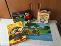 Curious George ( set of 5 items) puzzle, shirt, two carry cases, and George doll in Ramstein, Germany