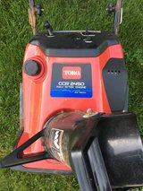 Toro 2450 snow blower starts and runs good very good paddles summer time special in Yorkville, Illinois