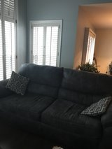 dark grey couch with off white stitching in Schaumburg, Illinois