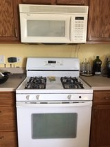 Whirlpool Gas range and microwave in Bartlett, Illinois