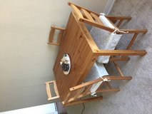 rectangular brown wooden table with four chairs dining set in Palatine, Illinois