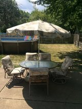 Patio set chairs, cushions, table and umbrella in Naperville, Illinois