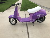 Purple electric scooter in Katy, Texas