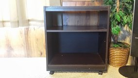 Wood roller TV display table in Fort Riley, Kansas