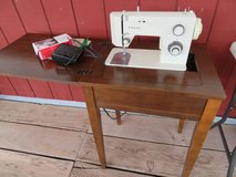 Singer sewing machine and cabinet in Alamogordo, New Mexico