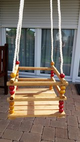 Toddler/ Baby swing made of solid wood - NEW in Spangdahlem, Germany