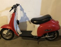 Little red motor scooter in Morris, Illinois