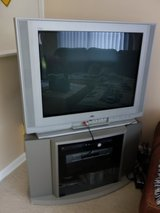 TV and TV Stand in St. Charles, Illinois