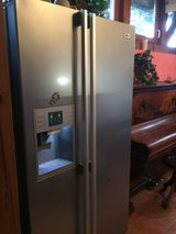 Price reduced- LG side by side fridge with ice maker in Stuttgart, GE